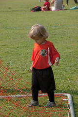 Matiás 1st soccer game (2) (tommaync) Tags: matiás grandson soccer durham nc northcarolina woodcroft field grass net goal nikon d40 september 2016 orange shirt