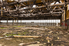 Interior of Hangar (Photo Kubitza) Tags: abandoned alberta architecturalphotography beam cable canada chain dirty doors frame geotag geotagged girder glass hangar indoor industrial interiorarchitecture kirkcaldy kirkcaldyaerodrome old photographicart roof steel used wall windows wood ca