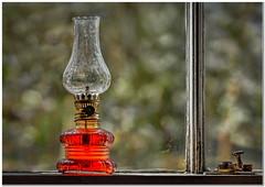 The paraffin lamp (Hugh Stanton) Tags: window latch lamp frame