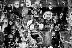 behind the mask (marin.tomic) Tags: city travel italien carnival venice blackandwhite bw italy reflection window monochrome shop canon europe italia mask souvenir venetian venezia confusion venedig veneto eos550