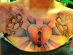 heart ray brass knuckle spiderweb chest tattoo by Wes Fortier