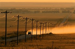 Long Road to Town, Colorado (JC Richardson) Tags: road travel nikon sundown powerlines lonely prairie dust plains distance longroad nationalgeographic greatplains jimrichardson