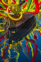 The Leaf and the Carnival | Dallas Arboretum (tookephoto) Tags: carnival red sculpture reflection green chihuly art fall glass pool yellow garden boat dallas leaf texas floating dallasarboretum carnivalboat
