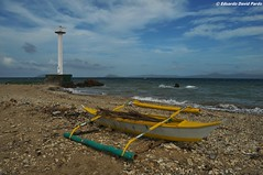 Lighthouse and boat (D Pardo) Tags: ocean travel sea lighthouse beach landscape boat scenery banca romblon tablasisland sanagustinport