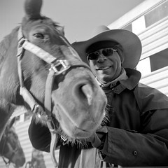 (patrickjoust) Tags: street city portrait urban bw horse usa white man black 120 6x6 tlr blancoynegro film home smile hat analog america lens us reflex md focus cowboy fuji mechanical united north patrick twin maryland baltimore medium format states manual 80 joust ricoh develop estados superricohflex f35 blancetnoir unidos schwarzundweiss fujifilmneopan100acros autaut martinlutherkingjrparade patrickjoust developedinrodinal