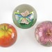4030. Three Art Glass Paperweights