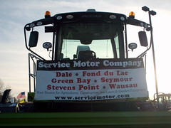 Service Motor Company Banner On A Claas Self Propelled Forage Harvester. (dccradio) Tags: wisconsin mall farming equipment machinery ag agriculture wi agricultural farmequipment farmshow marshfield farmmachinery centralwisconsin shoppesatwoodridge marshfieldmall wisconsinfarming machineryshow agshowagricultureshow