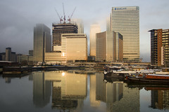 Canary Wharf sunrise (MartynHall ) Tags: morning cloud sun mist canada london tower fog sunrise buildings reflections square boats one golden office construction skyscrapers magic low hour wharf docklands block canary hsbc barclays eastend