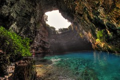 Melissani lake (Elios.k) Tags: blue light vacation lake color travelling green tourism water horizontal island crystal nopeople clear greece opening cave marketplace geology kefalonia hdr highdynamicrange sami melissani geological rocl karavomylos