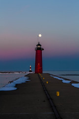 North Pier Light (olsonj) Tags: light moon lighthouse lake snow ice water evening pier twilight north fullmoon pierhead breakwater kenosha redlighthouse wisonsin