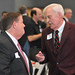 NC State Trustee Randy Ramsey, left, speaks with alumnus Bob Jordan after the luncheon.