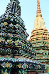 ~ Bangkok Wat Pho Dagoba~ (PS~~) Tags: trip travel sunset vacation sky holiday building art history tourism architecture cat thailand temple photography gold golden asia tour place earth spires bangkok buddha buddhist religion sightseeing buddhism grand palace tourist journey po planet  sight reclining traveling southeast ornate wat visiting pho statuary exploration hindu siam remains  touring deity bkk hindi illuminate thep streetcat   travelphotography plated rattanakosin krung   kingdomofthailand  totallythailand