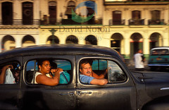 Cuba 9.2.3 (David Noton) Tags: life street old city travel people urban black west car horizontal automobile driving antique traditional capital transport culture scene move passengers busy transportation vehicle motor cuban crowded indies on the fashioned