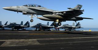 An F/A-18F lands aboard USS John C. Stennis.