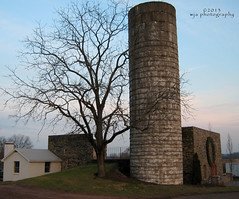 Leaning Tower of Silo? (Wendy A.) Tags: christmas winter sunset tree barn canon farm bluesky silo wreath tamron pinksky leaning barnfoundation christmaswreath fadinglight bankbarn