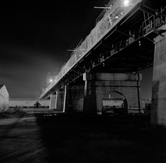 Arlington Bridge (AnniversaryRoad) Tags: 120 arlington arlingtonbridge bw canada kodak manitoba tmax winnipeg yashica yashicaa analog black blackandwhite bridge buildings film hair lights monochrome night outside tracks train traintracks trainyard trains white outdoor architecture nile river cn medium format tlr unlimitedphotos nolightmeter