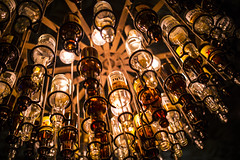 Finding Beauty in Alcoholism (Johnny Silvercloud) Tags: architecture arcs bars beer bottles canon canon5dmarkiii chandoliers curves dinner drinking eatingplaces food indoor lightroom5 lunch nightlife restaurant alcohol brown business geometry lines patterns yellow