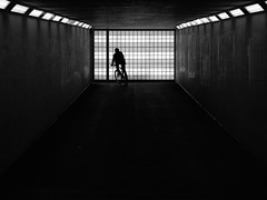 Way home (danielsteuri) Tags: danielsteuri switzerland world streetphotography olympus omd em10 mft microfourthird 14mm 45mm blackwhite bw candid moments moment creativecommons explore scout bestcamera primelens portrait scene scenery strassenfotografie fotografie city snap photography street unposed crop streetmonkey flowingones contrast light lights way bicycle evening tunnel grid trainstation cc home men