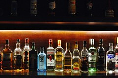 Weapons Of Mass Distraction (N A Y E E M) Tags: bottles alcohol spirits liquor shelf display collection lastnight light colors baikalbar hotel radissonblu chittagong bangladesh availablelight indoors