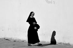 alone, with jesus (Stefano E) Tags: cagliari biancoenero blackandwhite street candid candidstreet strada suora nun sister jesus piazzapalazzo