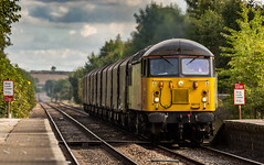 Colas Railfreight Class 56/0 no 56113 passes through Elton & Orston Station on 23-09-2016 with the Boston to Washwood Heath empty steel. (kevaruka) Tags: eltonorston leicestershire station autumn 2016 september colour colours colasrailfreight colas freighttrain dmu countryside eastmidlands nottinghamshire trains train transport trainstation railway networkrail britishrail class60 class56 england yellow orange flickr frontpage thephotographyblog ilobsterit stock canon canoneos5dmk3 canon5dmk3 canonef100400f4556l 5d3 5diii 5d 5dmk3 composition locomotive heritage historic lines leadinglines ruleofthirds boobs milf sexy wife scenic scenery trees green 56113