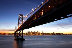 This City (jirfy) Tags: sf bridge blue sunset skyline island oakland bay twilight highway san francisco downtown waterfront treasure pyramid muni hour embarcadero transamerica yerba 80 108 ybi buena