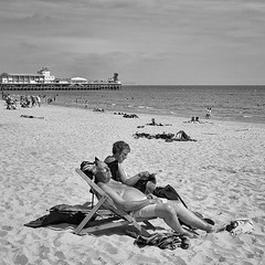 Holiday (Peter.Bartlett) Tags: street people blackandwhite beach monochrome mono blackwhite couple sitting chairs unitedkingdom candid sony streetphotography nik alpha 700 deckchairs blackdiamond ordinarypeople blackwhitephotos sonyalpha streetphotographyurban alpha700 sonyalpha700 niksilverefex