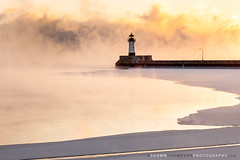 Canal Park North Pier 1-22-2013 (Shawn Thompson - Lake Superior Photographer) Tags: lighthouse cold ice minnesota clouds sunrise canal freezing steam mn duluth lakesuperior subzero canalpark