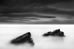 TWIN PEAKS (annemcgr) Tags: longexposure sea dublin water monochrome clouds blackwhite rocks le malahide