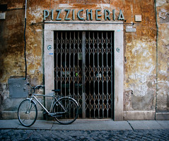 Pizzicheria (Melissa Maples) Tags: italy rome roma bicycle sign nikon europe italia doorway nikkor vr afs  18200mm f3556g  18200mmf3556g d5100