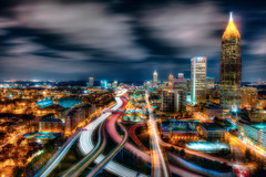 atlanta, georgia on february 27th (mudpig) Tags: longexposure bridge atlanta rooftop skyline night skyscraper georgia geotagged highway cityscape overpass interstate bluehour georgiatech i75 hdr lighttrail emoryuniversity yellowjackets mudpig traffictrail stevekelley citycscape stevenkelley bobblydoddstadium