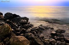 Sunrise (Ahmed Turki) Tags: light sea sun seascape beach water sunrise canon landscape eos rebel bahrain rocks details natur stunning t3i topshots mywinners theunforgettablepictures efs1855mmis canon600d ahmedturki 890904162