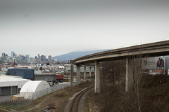 Skytrain bridge (williecb750) Tags: city bridge mountains vancouver skytrain