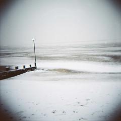 Snowy beach, Leigh-on-Sea (nick richards art) Tags: winter sea england white snow colour 120 thames landscape coast seaside lomo lomography sand 120film diana coastal analogue dianaf essex southend