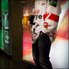 The Drinks (frischauge) Tags: street light red portrait people white color green ice cup sports hockey beer sport shirt headless standing fun person one 1 fan waiting funny colorful dri