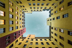 Yard (Philipp Gtze) Tags: blue houses sky berlin yellow buildings backyard perspective lookingup architektur hof hinterhof architrecture