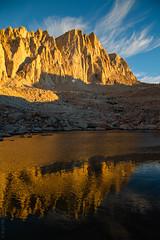 Whitney Gold (Kurt Lawson) Tags: california cliff mountain lake clouds rocks peak crest sierra whitney sierras needles mountwhitney sierranevada muir alpenglow highsierra