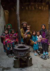 Afghan family in front of a stove, Badakhshan province, Khandood, Afghanistan (Eric Lafforgue) Tags: adobe afghan366 afghanistan badakhshanprovince centralasia children cold colourimage community cultural darkness family groupofpeople heater home house houses indoors interior ismaili khandood lifestyles lookingatcamera photography poverty residential scene simple simplicity sitting stove togetherness vertical wakhan wakhi women pamir