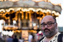 A portrait with a thousand lights (Iversaur) Tags: tibidabo barcelona carrousel portrait 50mm bcn amusement park lights