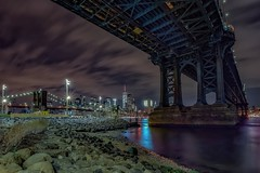 Underneath (karinavera) Tags: travel nikond5300 nyc dumbo night brooklyn under cityscape wtc urbanexploration underneath newyork manhattan longexposure bridge