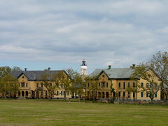 Sandy Hook Lighthouse seen from the Fort Hancock Parade Ground (Dendroica cerulea) Tags: building field sky clouds autumn bioblitz2016 nationalparksbioblitz2016 nps100 sandyhookbioblitz2016 sandyhookbioblitz bioblitz usnationalregisterofhistoricplaces nationalregisterofhistoricplaces forthancockandsandyhookprovinggroundnationalhistoriclandmark forthancock sandyhooklighthouse sandyhook gatewaynationalrecreationarea monmouthcounty nj newjersey
