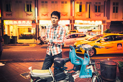 Streets of Joo Chiat (Jon Siegel) Tags: nikon d810 sigma 24mm 14 sigma24mmf14art man plaid shirt smoking smoke fast speeding cars street glow outdoors night evening chinese singapore singaporean taxis taxi bike people cinematography cinematic fashion style