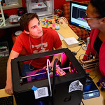 Students using the 3-D printer in the Media and Education Technology Resource Center.