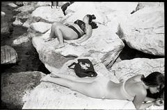 (Before And After) (Robbie McIntosh) Tags: leicam2 leica m2 rangefinder streetphotography 35mm film pellicola analog analogue negative leicam summilux analogico leicasummilux35mmf14i blackandwhite bw biancoenero bn monochrome argentique summilux35mmf14i autaut dyi selfdeveloped filmisnotdead strangers candid arsimagofd arsimagofddeveloper kentmere100 kentmere 100 summertime bathers rocks beach sea girl woman mappatellabeach lidomappatella ass booty cheeks bikini