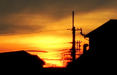 We Need Solar Power (Keith Mac Uidhir  (Thanks for 3m views)) Tags: city travel light sunset shadow red summer sky orange house hot building luz silhouette yellow japan river asian fire japanese evening solar kyoto asia power cable line pole wires electricity mast ward luce