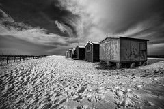 footprints in the snow (stocks photography) Tags: snow beach seaside stocks beachhuts seasalter footprintsinthesnow downonthebeach coastalphotography stocksphotography michaelmarsh theperfect10