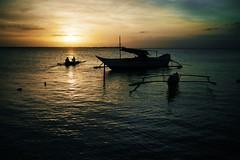{cebu island} : sunset departure (ktrap) Tags: sunset boats island fishermen philippines silhouettes boating tropical cebu departure