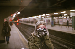 ° (333Bracket) Tags: winter reflection london film girl train 35mm underground mirror bokeh tunnel gloves analogue nikonfg nikone50mmf18 333bracket