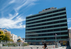 The former Government Life building (Jocey K) Tags: road street city trees newzealand christchurch sky people architecture clouds fence buildings bikes nz sq cathedralsquare roadcones earthquakedamage governmentlifebuilding
