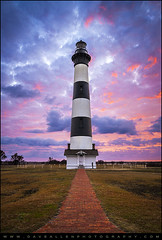 Bodie Island Lighthouse Sunrise OBX Outer Banks NC - The Gatekeeper (Dave Allen Photography) Tags: ocean travel pink sunset red vacation sky lighthouse beach beautiful vertical sunrise landscape island photography dawn coast nationalpark nc nikon colorful paradise lighthouses purple gorgeous scenic northcarolina landmark atlantic hatteras coastal national nagshead carolina cape bodie outer dramaticsky outerbanks beacon banks striped obx eastcoast daveallen capehatteras easternnc bodieislandlighthouse carolinas atlanticcoast d700 mygearandme mygearandmepremium mygearandmebronze mygearandmesilver mygearandmegold mygearandmeplatinum mygearandmediamond